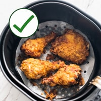 chicken on parchment for safe air frying and air fryer safety tips