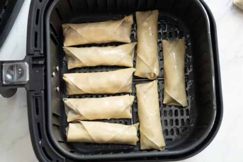 Egg rolls in air fryer basket