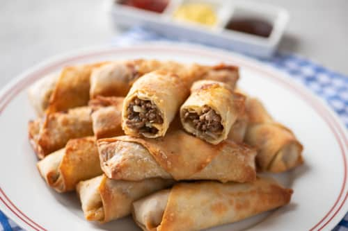 Egg rolls served with ketchup and mustard