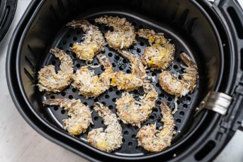 Uncooked coconut shrimp in air fryer