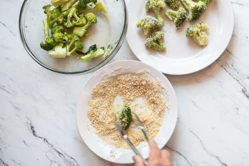 Dredging broccoli in bread crumbs