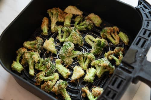 Laying broccoli in a single layer in air fryer