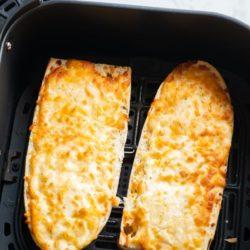 cooked garlic bread in an air fryer basket