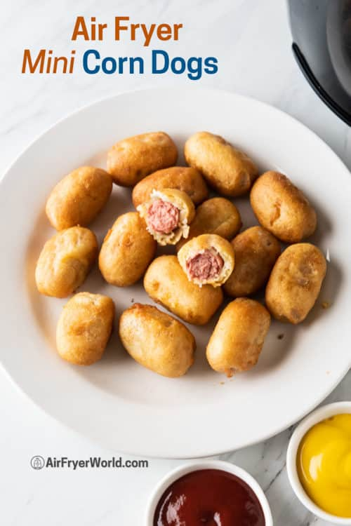 Mini corn dogs on a plate with ketchup and mustard
