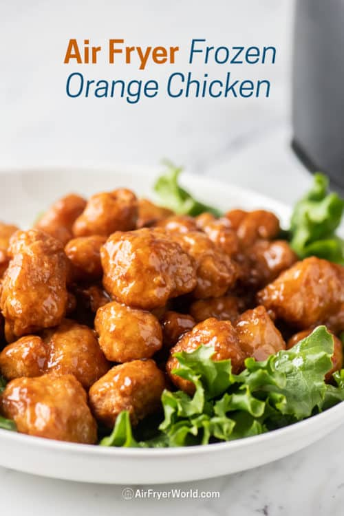 Orange chicken in a bowl covered with orange sauce