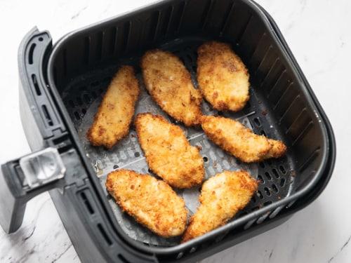 Cooked tenders in air fryer basket