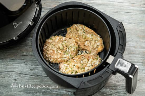 Uncooked pork chop in air fryer