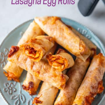 Plate of lasagna egg rolls with one cut in half from airfryerworld.com