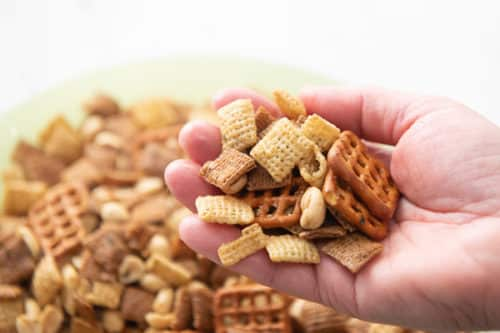 Finished air fryer snack mix in the hand