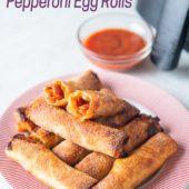 Plate of crispy pepperoni pizza egg rolls from airfryerworld.com