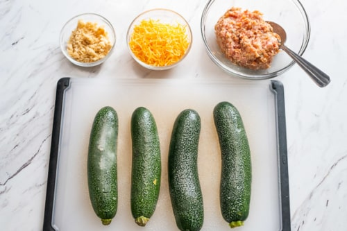 Zucchini halves skin side up and sprayed with oil