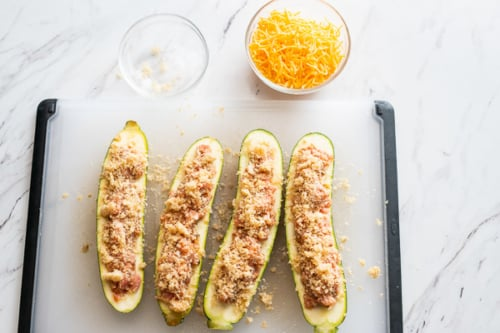Zucchini stuffed with sausage and breadcrumbs, cheese in a bowl