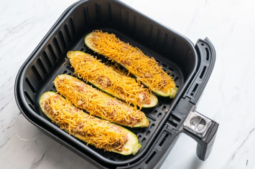 Stuffed zucchini in air fryer basket