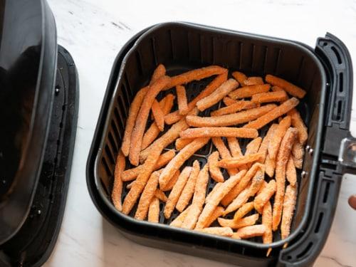 Frozen sweet potato fries in a single layer