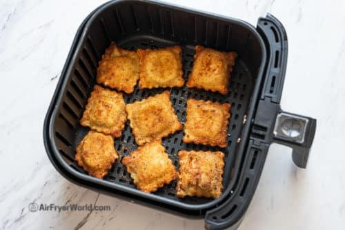 crispy ravioli in air fryer basket