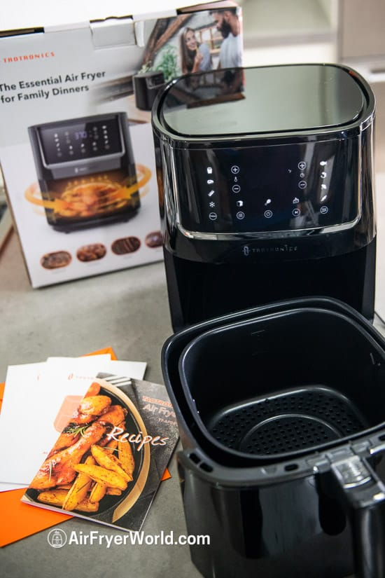 air fryer on kitchen counter with box